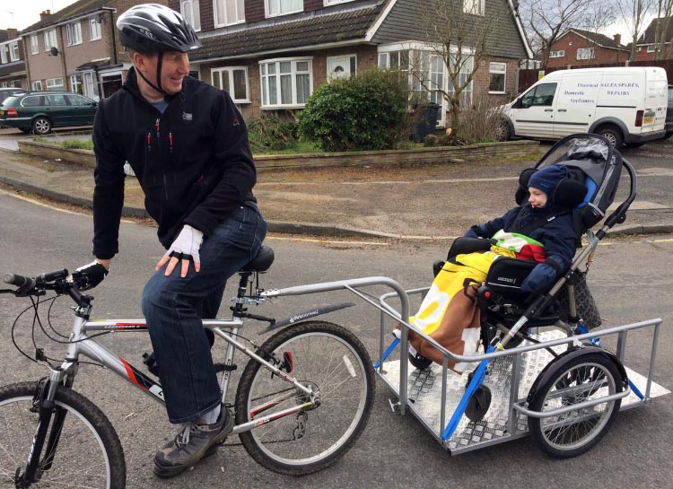 Stam takes his son Sean for his first bike ride! Photo published with the kind permission of Mark Corry