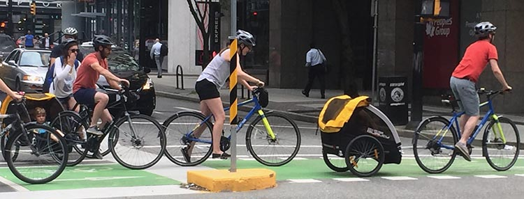 One day I saw about 4 parents transporting kids on the Vancouver separated bike lanes at the same time!