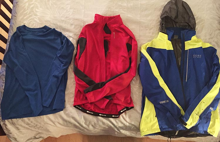 Above are 3 layers of cycling clothing: from left, an Under Armor type base layer; a warm fleece-lined cycling jersey layer; and over top a great waterproof cycling jacket