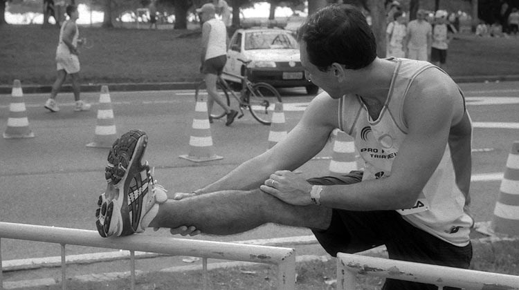 Proper stretching enables optimal athletic performance, as with the triathlete pictured here. Photo from Fabio Mascarenhas on Flickr