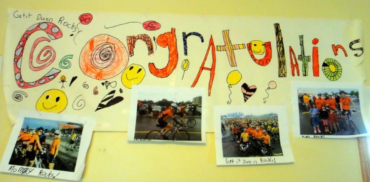 A cheering banner that Karen's kids drew to encourage her on her very first Ride to Conquer Cancer - it hangs in her kitchen to this day!
