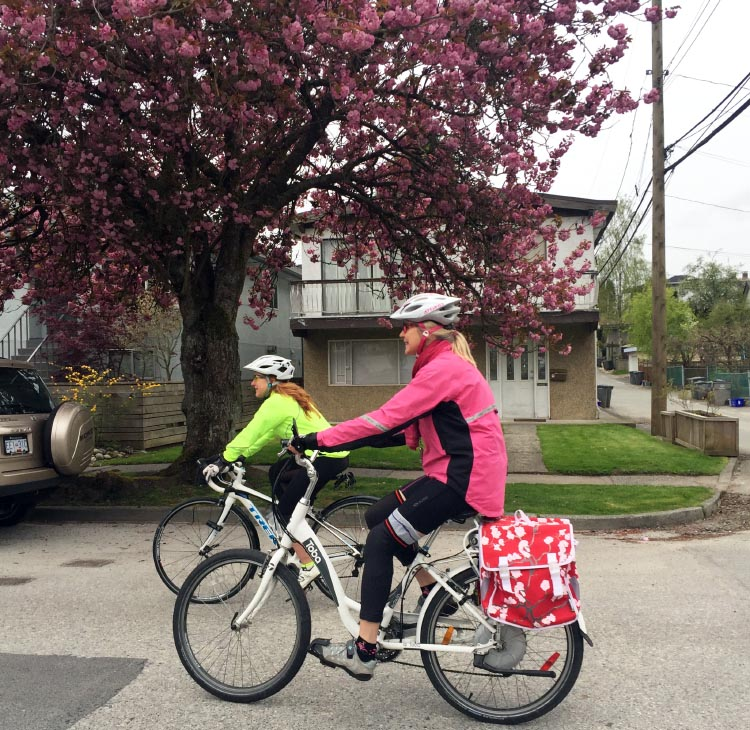 Here is Linda Poole cycling in the Bike the Blossoms ride that she organizes!