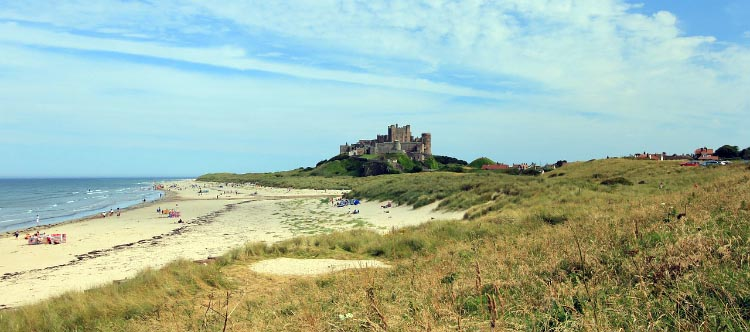 This photo shows Bamburgh Castle. You can also find holiday cottages in Bamburgh