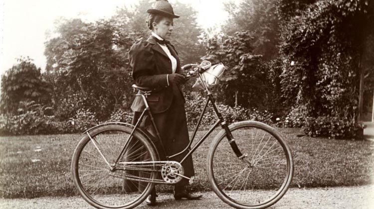 A woman's bike was expected to have a dropped, or diagonal, cross-support, rather than the horizontal one of a man's bike, in order to mitigate the issue of the raised leg. This came with the secondary, if dubious, benefit of allowing a lady to ride more easily in a full dress. This person was Alice Austen, one of the first female photographers, and a strong advocate for women cyclists (Alice Austen House)