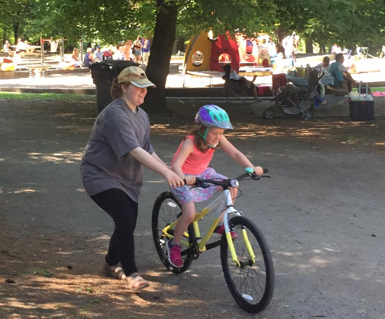 Queens Park in New Westminster is a perfect place to teach a child how to ride a bike. In this photo, my daughter is teaching my grand-daughter how to ride a bike!