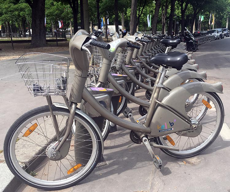 Lime Bikes and Scooters for Shared Transport Options. Velib shared bikes at a docking station in Paris, near the Champs-Élysées