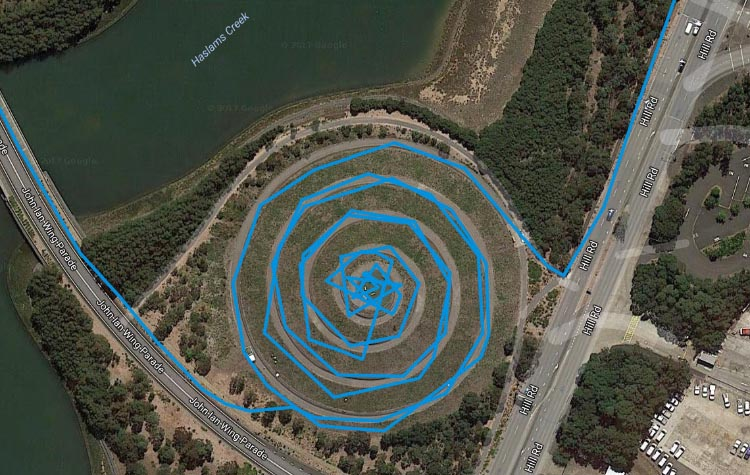 An aerial view of a spiral man made mountain in Sydney Olympic Park