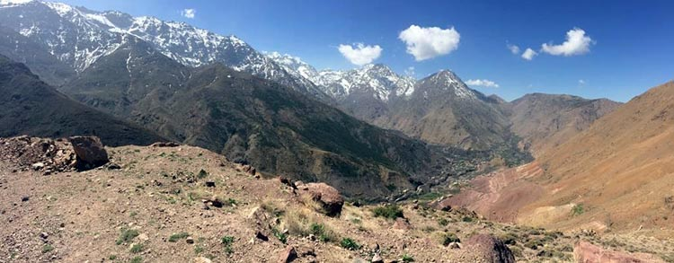 Cycling in the Atlas Mountains in Morocco. As we drive south from Marrakech, snow peaked mountains are ahead (snow in Africa – it just feels wrong!)