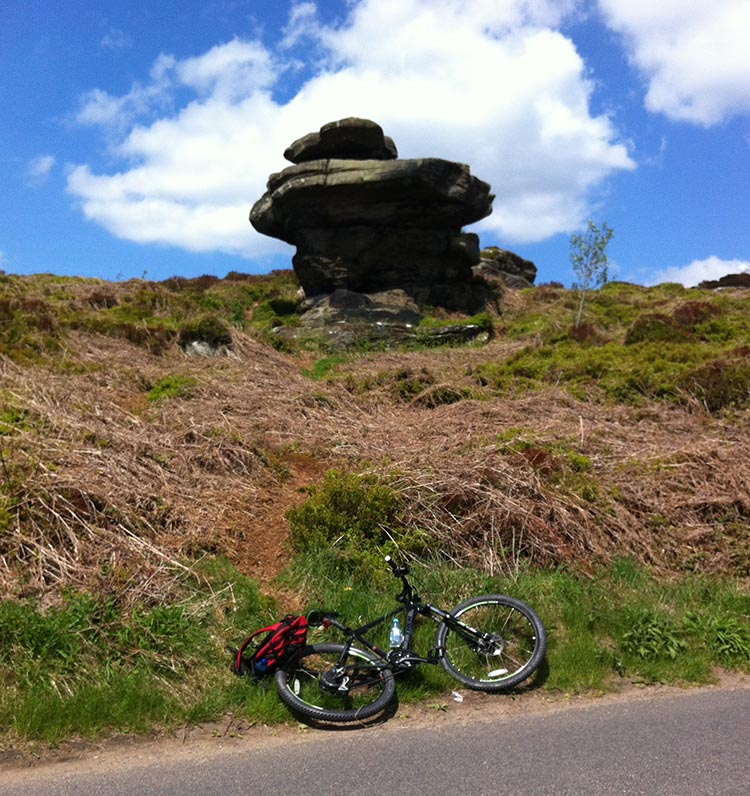 The Way of the Roses – Cycling Coast to Coast Across England bike next to rock