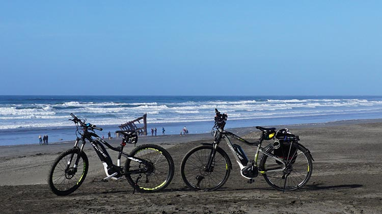 Here are our bikes on Peter Iredale Beach. The wreck is just visible in the distance!