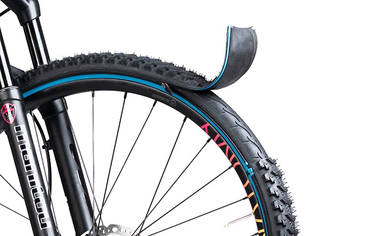 Introducing reTyre – Skins for Bike Tires! Enter to win a set. You put reTyre base tires on your bike, and then you can adapt to changing conditions by zipping on a skin