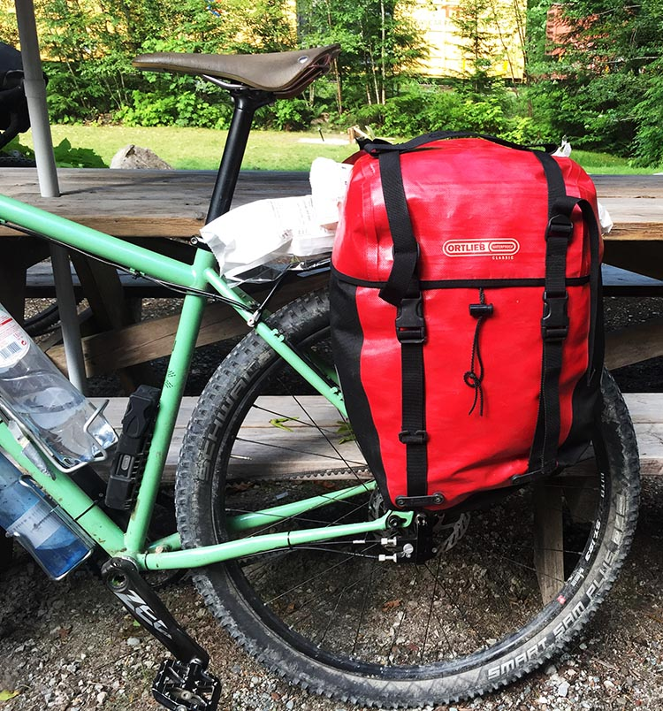 Ortlieb panniers on a bike at a campsite