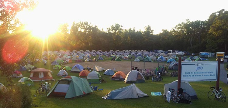 Cyclists spend the nights in tents along the way
