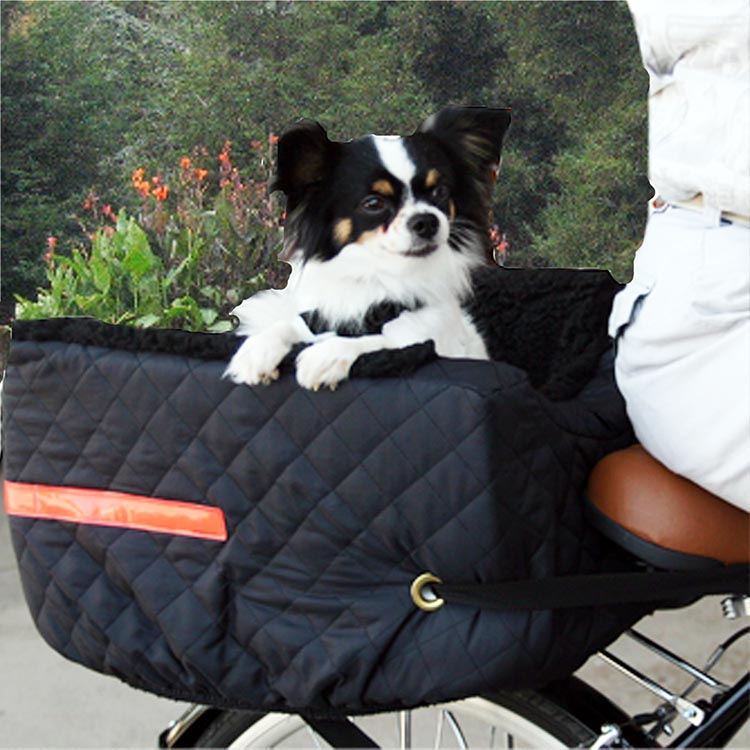"5 of the Best Dog Bike Baskets to Safely Take Your Dog Cycling in 2020. The Snoozer Rear Mounted Pet Rider Pet Bike Basket is very comfy, and comes for a company whose slogan is ""Where Dogs get Happy""!"