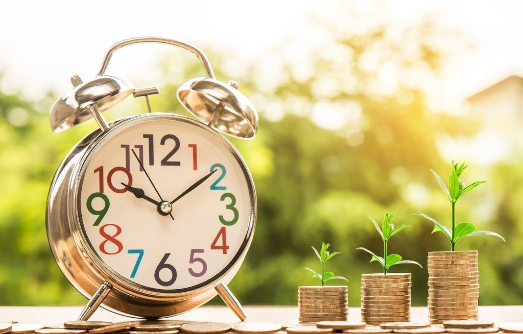 Clock with money growth