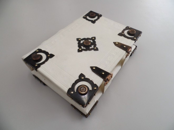 Gothic binding in alum-tawed pigskin with brass centerpiece, corner pieces, and clasps