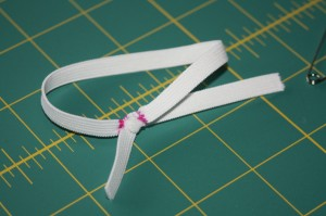 tie elastic into loop and use it in your hair to see if it's a good length-if it is, then mark it and untie knot