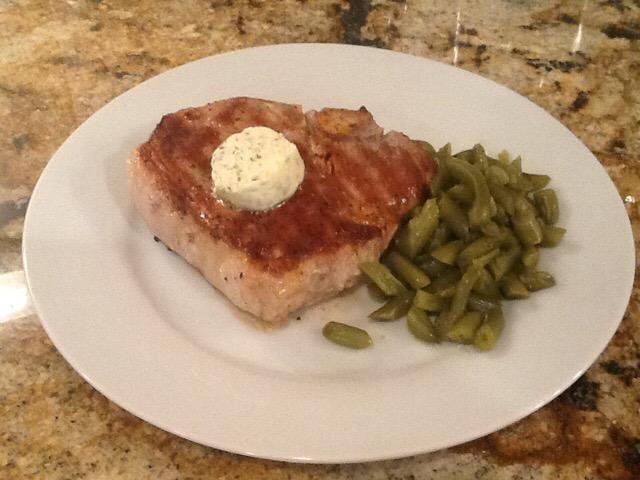 Porterhouse cut pork chops with oregano compound butter