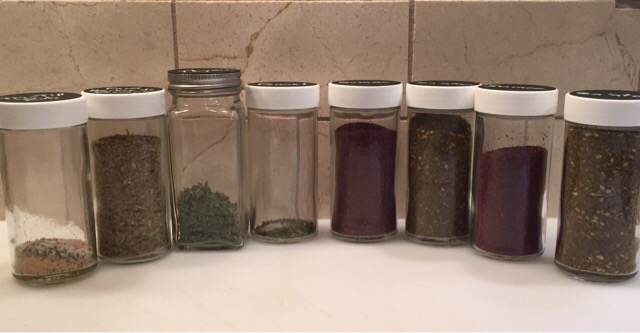 Putting Dried Thyme and Fennel in Jars