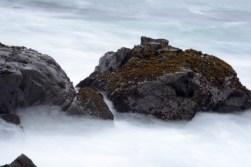 ocean rocks in white mist