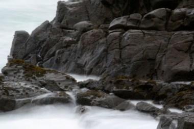 black ocean rocks, white mist