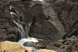ocean rocks waves form waterfalls