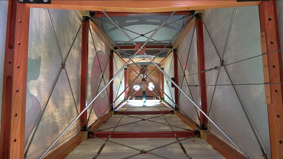 This view from the observer/gunners cockpit shows the internal framing and bracing in the rear fuselage of the aircraft. From a distance is easy to think of a linen covered aircraft to be quite solid, but this image highlights that these aircraft really were just made up of wood, wire and 'canvas'. Photo Copyright © Historical Aviation Film Unit.