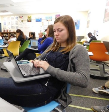 Senior Kayla Kirtz and classmates work on their research papers in the new swivel desks.