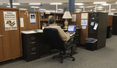 Mr. Brewer works at his desk after school.