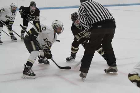 Amy Breckner facing off for the puck.