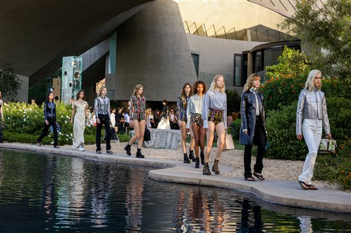 Models walk the runway at the Louis Vuitton Cruise Show at the Bob and Dolores Hope Estate on May 6, 2015, in Palm Springs, Calif.