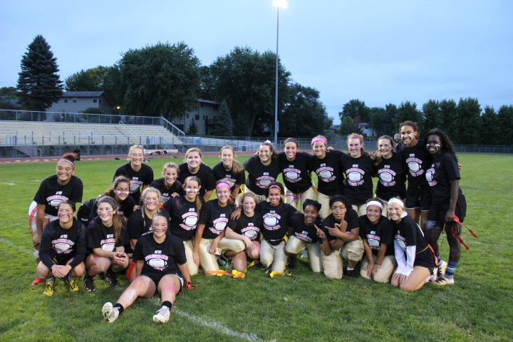 Apple+Valley%27s+senior+and+junior+girls+smile+for+their+post-Powder+Puff+photo.