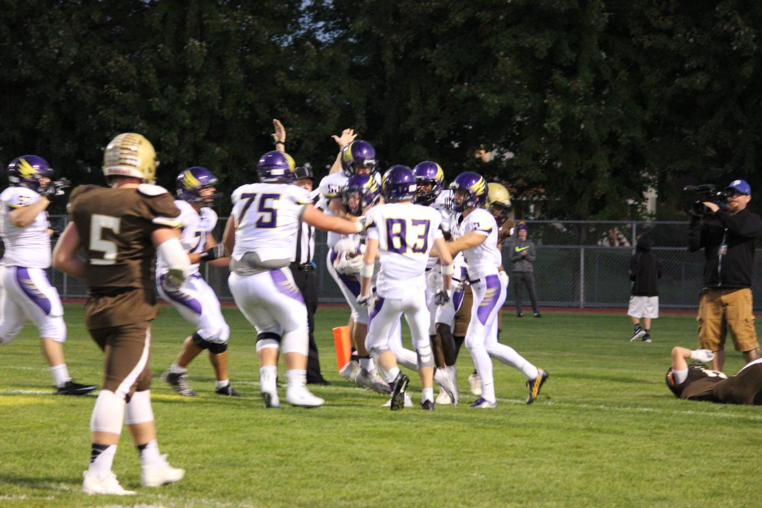 Chaska celebrates its first touchdown in a win over Apple Valley in AVHS' homecoming game.
