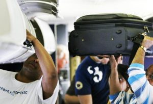 Passenger does good deed closing overhead bin and fractures shoulder: Is airline liable? 13