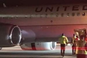 United Airlines jet with burning engine makes emergency landing in Newark