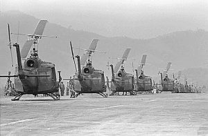 Helicopters of the 170th and the 189th Helicopter Assault Companies, await the leading of troops at Polei Kleng, in the Central Highlands of the Republic of South Vietnam., 04/10/1969