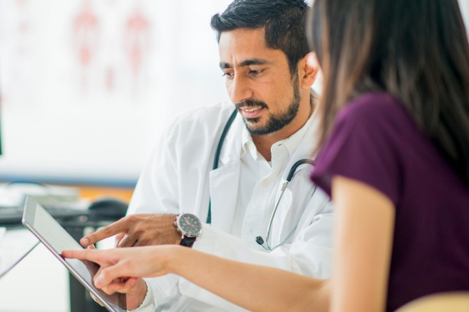 doctor speaking to patient in medical office