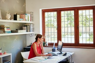 woman working in home office on computer