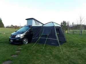 External awning next to camper van