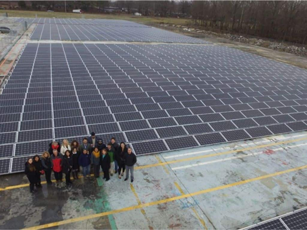 humbolt emerson solar pv system with a group of people standing for a photo.
