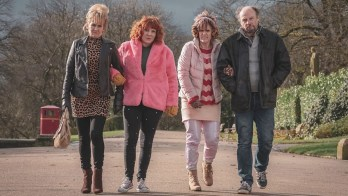 Sophie Willan Alma's Not Normal in pink coat arm in arm with Grandma( (Lorraine Ashbourne), mother (Siobhan Finneran) and Jim (Nicholas Asbury) and