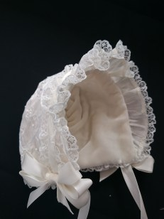 Lined with silk velet, this gorgeous bonnet should keep the little darling's head warm.