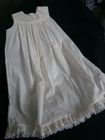 The cotton underdress with ruffle and vintage lace.