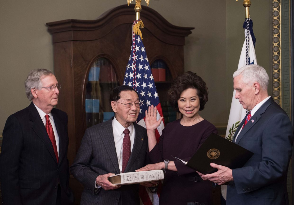 Elaine Chao is sworn in as transportation secretary by Vice President Mike Pence, right, as her father, James Chao, second from left, and her husband, Senate Majority Leader Mitch McConnell, look on in Washington, D.C., on Jan. 31, 2017