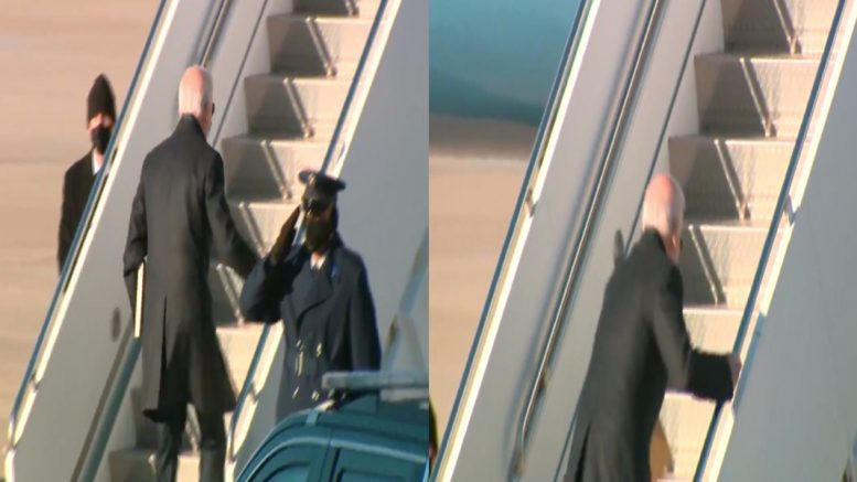 Joe Biden stumbling as he climbs stairs to his plane.