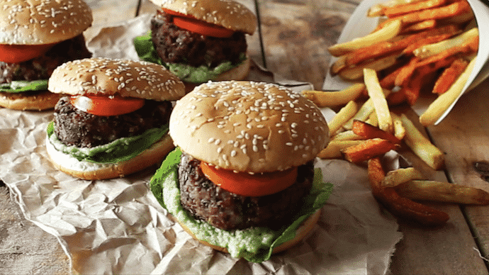 black bean burgers in buns with fries on the side