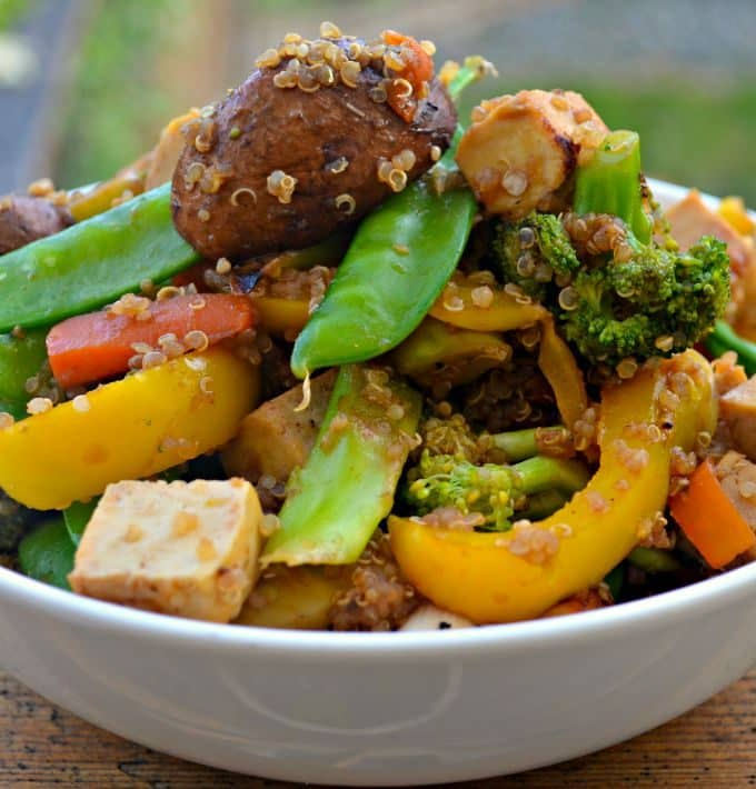 This Tofu & Quinoa Stir Fry is quick, easy and very healthy. It is also packed full of protein and can be ready in under 20 minutes!