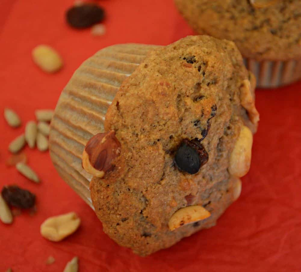 Tender spelt flour trail mix muffins. Easy to make and perfect for a grab and go breakfast or healthy, energy boosting snack. Egg free & dairy free.