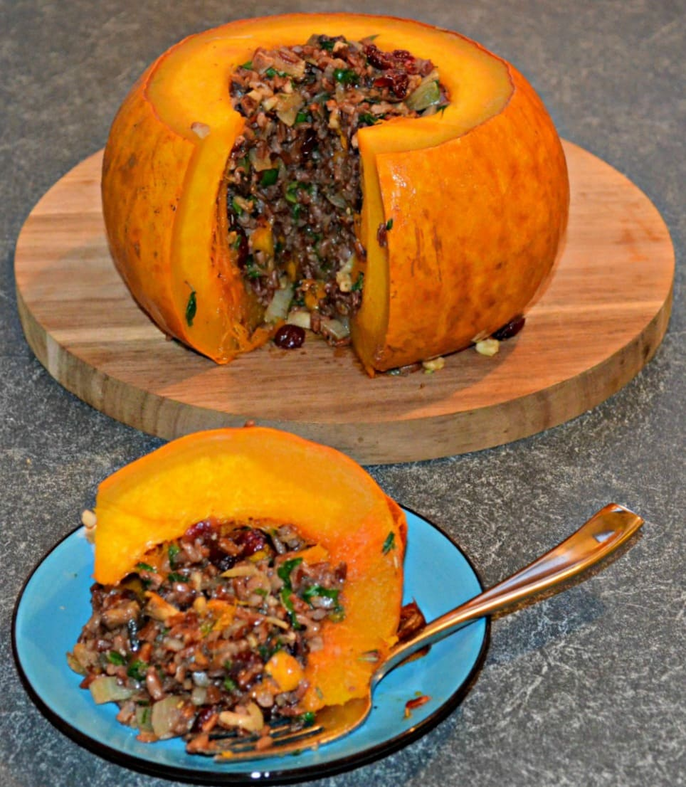 Tender, sweet, baked stuffed pumpkin with a delicious mixture of rice, vegetables, nuts & cranberries. A beautiful centrepiece for your Thanksgiving or Halloween gathering!