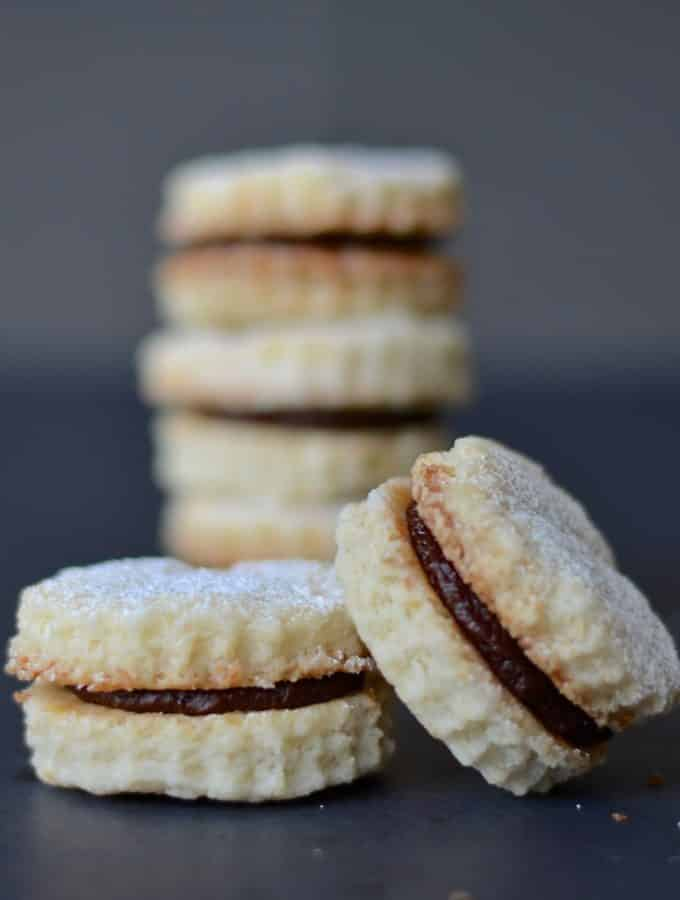 Melt in your mouth Chocolate Coconut Cream Cookies sandwiched together with a rich chocolate & coconut cream. Little morsels of deliciousness that taste like way more effort went into making them than it actually did!
